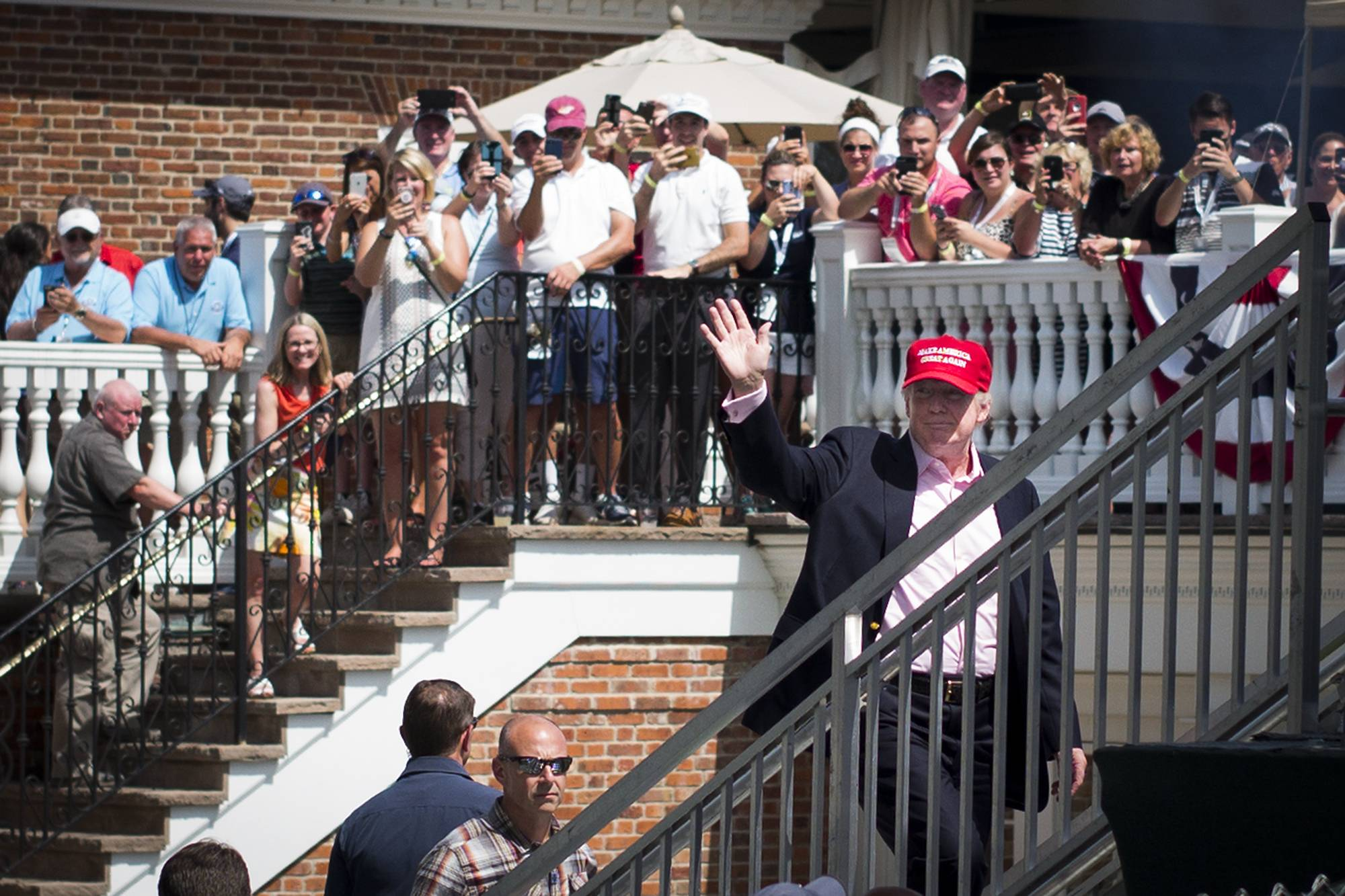 U.S. President Donald Trump waves to the crowd during the final round of the U.S. Women's Open at Trump National Golf Club in Bedminster, New Jersey, on July 16, 2017. | USA TODAY / VIA REUTERS
