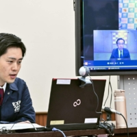 Osaka Gov. Hirofumi Yoshimura speaks during an online meeting with the governors of Kyoto and Hyogo prefectures on Saturday in the city of Osaka. | KYODO