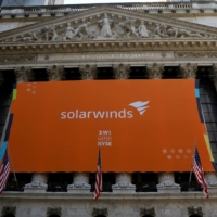 A SolarWinds Corp. banner hangs at the New York Stock Exchange on Oct. 19, 2018. | REUTERS