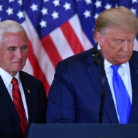 U.S. President Donald Trump and Vice President Mike Pence speak at the White House in Washington on Nov. 4. | AFP-JIJI