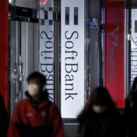 A former SoftBank Corp. employee has been arrested on suspicion of illegally disclosing 5G trade secrets to his new employer, Rakuten Mobile Inc. | BLOOMBERG