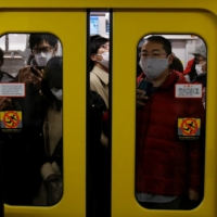 The pandemic has made teleworking a viable option for many companies in Japan. | REUTERS