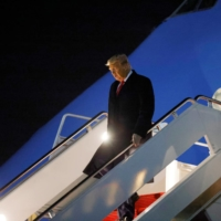 U.S. President Donald Trump disembarks from Air Force One on Tuesday.  | REUTERS