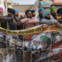 Farmers protesting on New Delhi's border in the village of Singhu on Jan. 4. India's highest court on Tuesday halted the implementation of new laws that would reshape farming in the country and that sparked huge protests outside the capital. | SAUMYA KHANDELWAL / THE NEW YORK TIMES