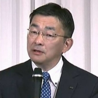 KDDI Corp. President Makoto Takahashi speaks during a news conference in Tokyo on Wednesday. | KYODO