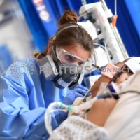 Medical workers care for a patient at the intensive care unit at Royal Papworth Hospital, in Cambridge, England, in May.  | POOL / VIA REUTERS
