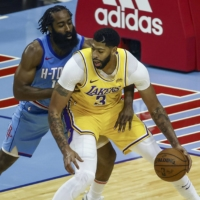 Rockets guard James Harden (left) defends against Lakers forward Anthony Davis during the third quarter on Tuesday in Houston. | USA TODAY / VIA REUTERS