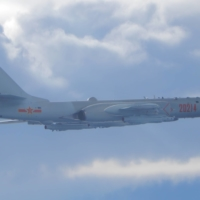 A People's Liberation Army H-6 bomber flies on a mission near the median line over the Taiwan Strait, which serves as an unofficial buffer between China and Taiwan, in September. | TAIWAN MINISTRY OF NATIONAL DEFENSE / VIA REUTERS
