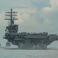 The USS Ronald Reagan aircraft carrier, the Maritime Self-Defense Force destroyer Teruzuki (center) and the USS Mustin destroyer sail in formation in the Philippine Sea last July. | U.S. NAVY / VIA REUTERS