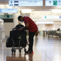 Few passengers passed through the arrival lobby for international flights at Haneda Airport on Jan. 5.