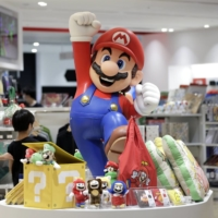 Universal Studios Japan will postpone the opening of its much-anticipated Super Nintendo World theme park due to a surge in coronavirus cases. | BLOOMBERG