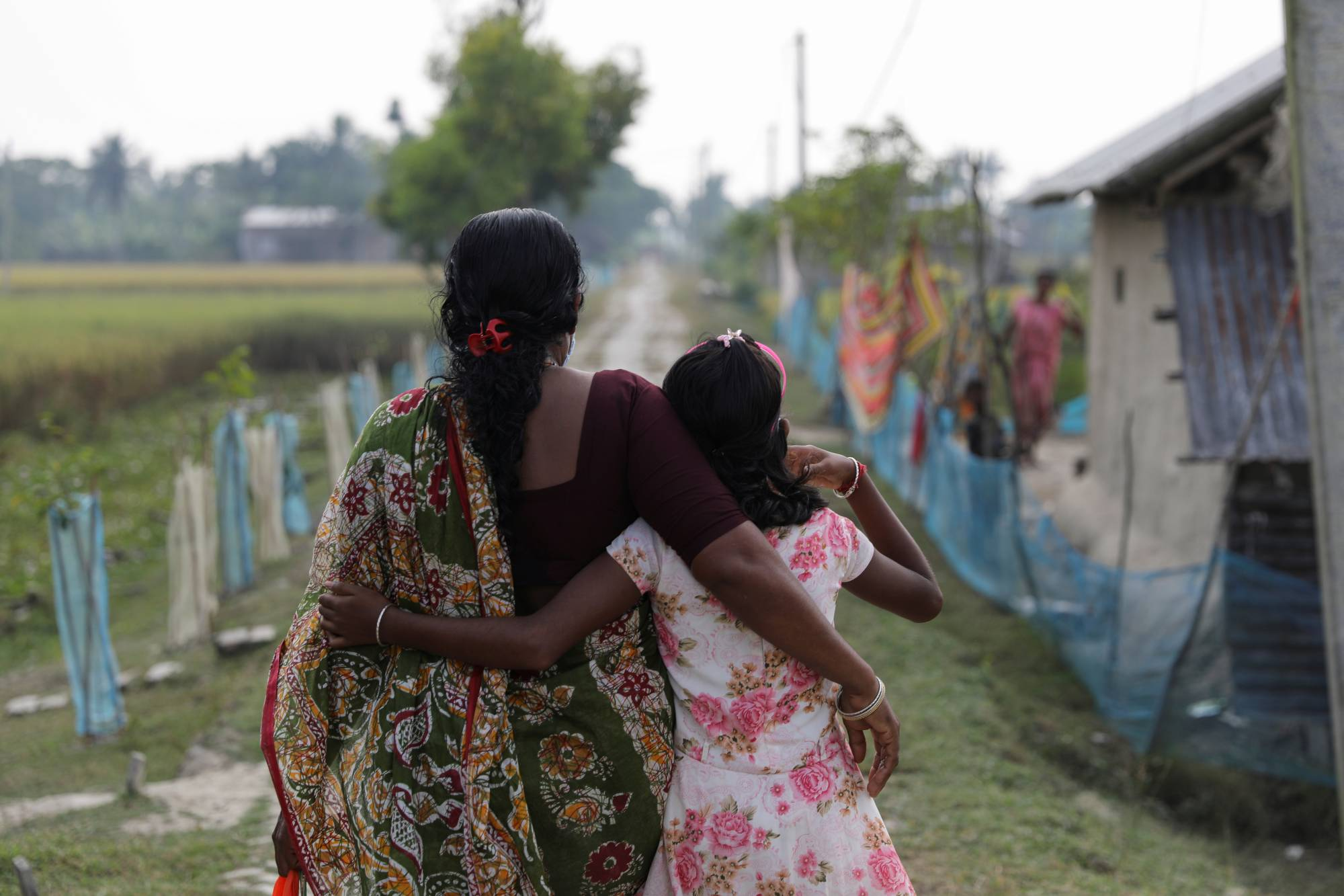 Parul Haldar, 39, whose husband died in a tiger attack during a fishing trip, and her daughter Papri Haldar, 11 | REUTERS