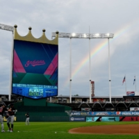 A partial rainbow appears past the scoreboard as the Indians warm up before the game against the Royals at Kauffman Stadium, in Kansas City. Missouri on July 25.   | USA TODAY / VIA REUTERS