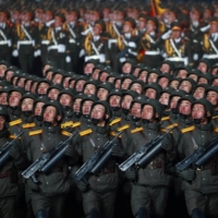 Troops march during a military parade to commemorate a ruling Workers' Party of Korea congress in Pyongyang on Thursday.  | KCNA / VIA REUTERS