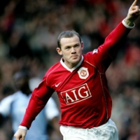 Manchester United's Wayne Rooney celebrates after scoring against Manchester City during a match at Old Trafford on Dec. 9, 2006. | AFP-JIJI