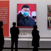 People visit an exhibition about China's fight against the coronavirus at a convention center that was previously a makeshift hospital for coronavirus patients in Wuhan, China, on Friday.