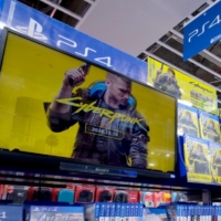 A screen showing a promotional video for Cyberpunk 2077 at a store in Tokyo in December.  | AFP-JIJI
