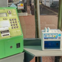 This provided photo shows a mobile phone charger set up inside a public phone booth by Nippon Telegraph and Telephone West Corp. (NTT West) and Inforich Inc. | KYODO