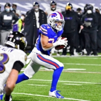 Bills cornerback Taron Johnson runs an interception back for a touchdown against the Ravens during their AFC divisional playoff game on Saturday in Orchard Park, New York. | USA TODAY / VIA REUTERS