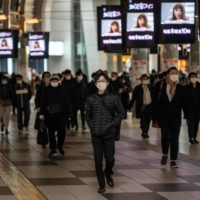 Shinagawa Station in Tokyo last week. The capital confirmed 1,592 new COVID-19 cases on Sunday, nearly 100 more than the record for a Sunday set last week. | AFP-JIJI
