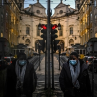 A woman is reflected in a shop window in Lisbon on Friday as Portugal entered a fresh lockdown over a surge in coronavirus cases.  | AFP-JIJI