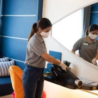 A worker disenfects a room at Hotel Clover Patong Phuket in December.  | BLOOMBERG