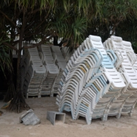 Beach chairs are stacked on Patong beach. | BLOOMBERG