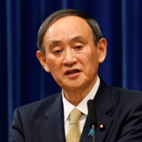 Prime Minister Yoshihide Suga speaks during a news conference at the prime minister's official residence in Tokyo on Wednesday. | POOL / VIA REUTERS