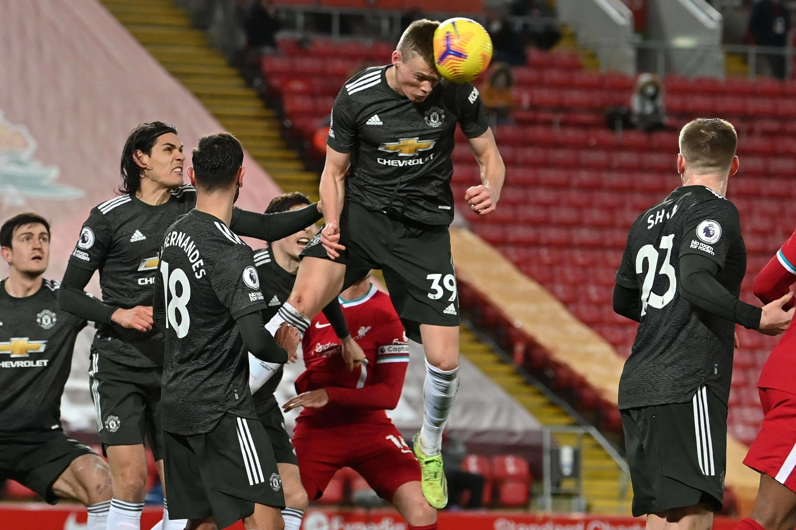 Manchester United midfielder Scott McTominay heads the ball during his club's match against Liverpool at Anfield in Liverpool, England, on Sunday. | AFP-JIJI