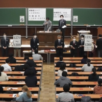 Students take the standardized university entrance exams at the University of Tokyo on Saturday. | KYODO