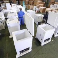 Special freezers that can store COVID-19 vaccines are kept at a company facility in Sagamihara, Kanagawa Prefecture, on Wednesday.