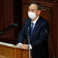 Prime Minister Yoshihide Suga delivers his policy speech at the opening of the Lower House parliamentary session in Tokyo on Monday.   | REUTERS