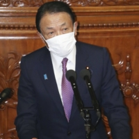 Finance Minister Taro Aso delivers a speech at the Lower House plenary session Monday. | KYODO