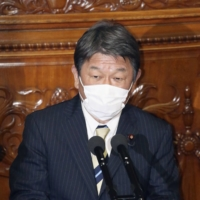Foreign Minister Toshimitsu Motegi delivers a speech at the Lower House plenary session Monday. | KYODO