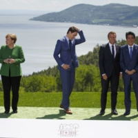 Leaders including the U.K.'s Theresa May (left to right), Germany's Angela Merkel, Canada's Justin Trudeau, France's Emmanuel Macron and Japan's Shinzo Abe at the G7 summit in La Malbaie, Quebec, in 2018   | BLOOMBERG