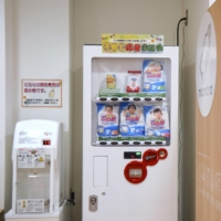 Some vending machines in Hokkaido provide formula and a water heater its preparation alongside diapers. | KYODO