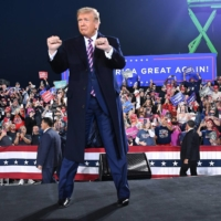 U.S. President Donald Trump arrives for a campaign rally at Pittsburgh International Airport in Moon Township, Pennsylvania, in September.  | AFP-JIJI