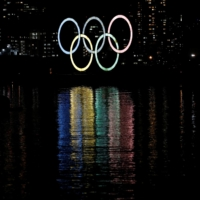 Giant Olympic rings are illuminated in Tokyo on Jan. 13.