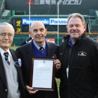 Chuck Mills (center) receives a certificate of appreciation celebrating the 40th anniversary of Utah State's 1971 exhibitions in Japan on Dec. 18, 2011, at Koshien Stadium in Nishinomiya, Hyogo Prefecture. | COURTESY OF P-TALK