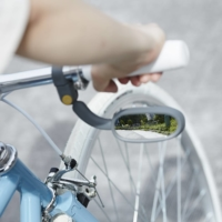 Cycle safety: Muni's rearview mirror, designed by Sari Nakamura, allows cyclists to see behind them at a glance.  