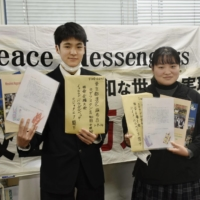 Student peace ambassadors hold letters they will send to countries supporting the nuclear weapons ban treaty in Nagasaki Prefecture on Jan. 8. | KYODO