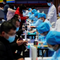 A COVID-19 vaccination center in Shanghai on Tuesday | REUTERS