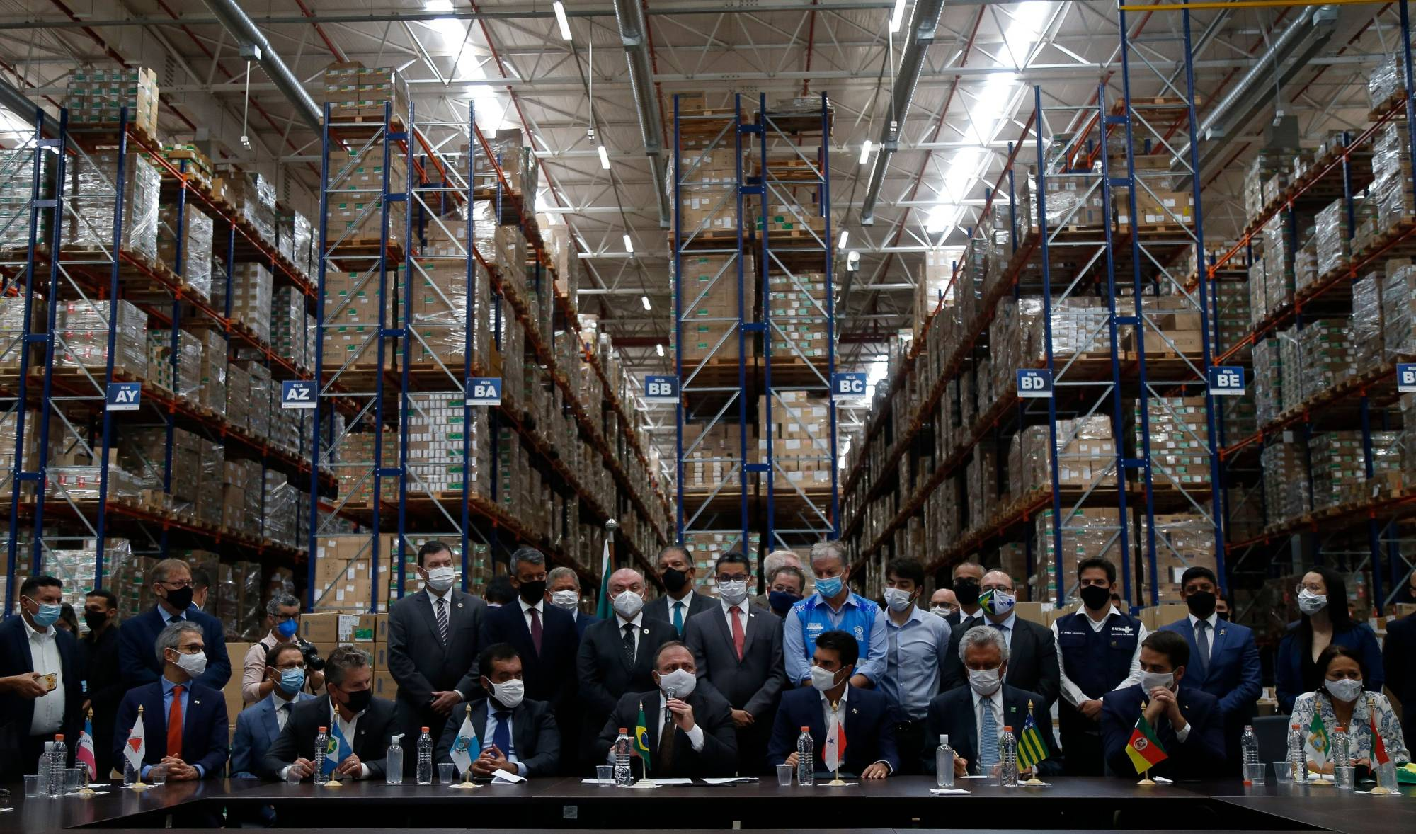 Brazil's Health Minister, Eduardo Pazuello (center), holds a news conference at a distribution center for Sinovac Biotech's COVID-19 vaccine in Guarulhos, Sao Paulo, on Monday. | AFP-JIJI