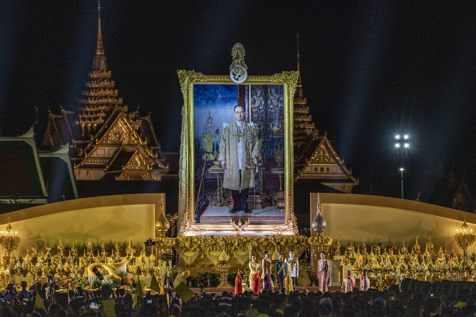 Thailand's king and queen preside over a ceremony in Bangkok on Dec. 5. to commemorate the late King Bhumibol Adulyadej's birthday. | ADAM DEAN / THE NEW YORK TIMES