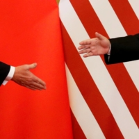 U.S. President Donald Trump and China's President Xi Jinping shake hands after making joint statements at the Great Hall of the People in Beijing on Nov. 9, 2017. | REUTERS