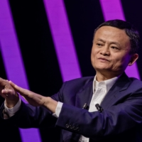 Jack Ma, chairman of Alibaba Group Holding Ltd., gestures while speaking at the Viva Technology conference in Paris in May 2019. | BLOOMBERG