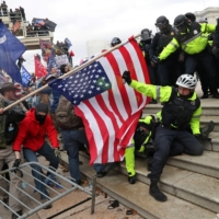 Members of U.S. Capitol Police try to fend off a mob of supporters of U.S. President Donald Trump as they storm the U.S. Capitol Building in Washington on Jan. 6.    | REUTERS