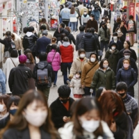 People walk in Tokyo's Harajuku district on Sunday. | KYODO
