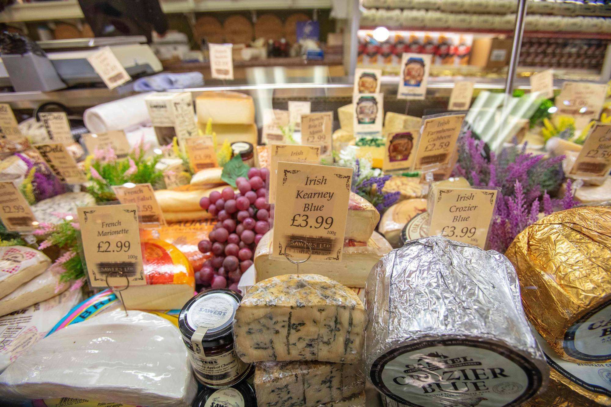 A range of Irish and French cheeses are seen on display in Sawers Deli in Belfast, Northern Ireland, on Jan. 15. Sawers Deli is struggling to source English cheese. They are now sourcing more French and Irish cheese, as it is easier to import since Brexit. | AFP-JIJI