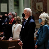 U.S. President-elect Joe Biden and his wife, Jill, attend a church service before his presidential inauguration, at St. Matthews Catholic Church in Washington on Wednesday. | REUTERS